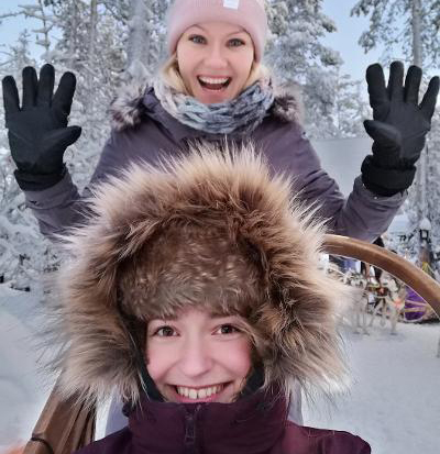 Dr Justine Bruvere and Dr Linda Kundzina on a sled